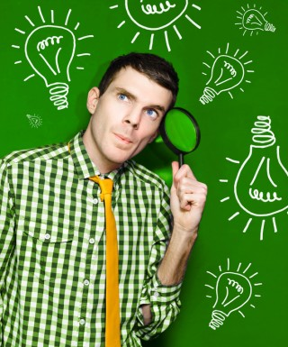 Businessman With Creative Idea On Green Background